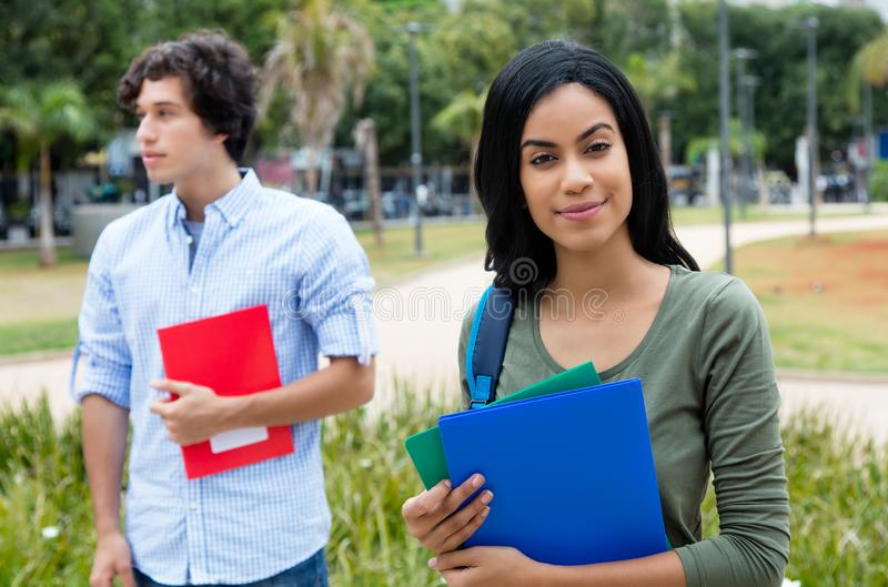 Smiling indian female student with caucasian male student royalty free stock photos