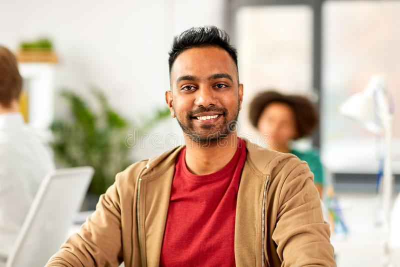 Smiling indian man at office royalty free stock photos