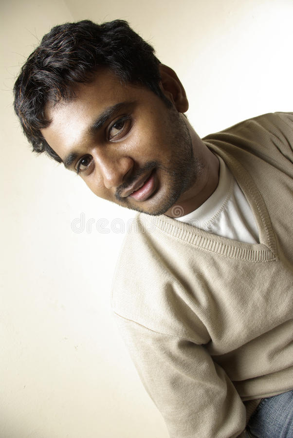 Download Smiling Indian young man stock photo. Image of posing - 24029484
