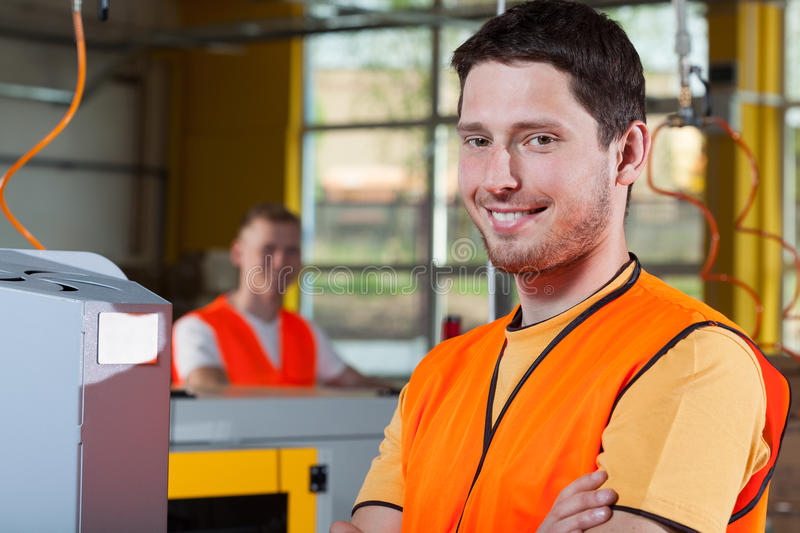 Smiling industrial worker at factory royalty free stock image