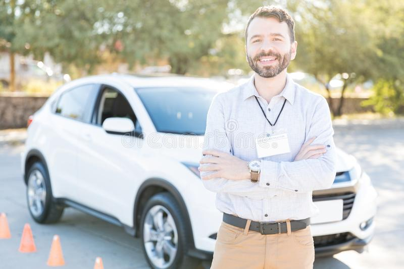 Smiling Instructor Ready To Teach Driving royalty free stock photography