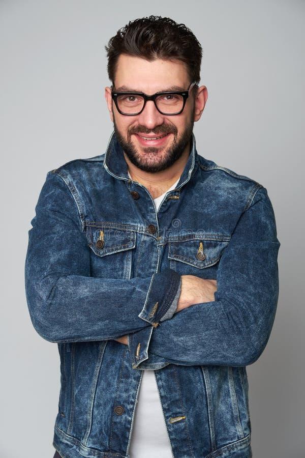 Smiling joyfully bearded man with glasses, dressed casually. Iso royalty free stock image
