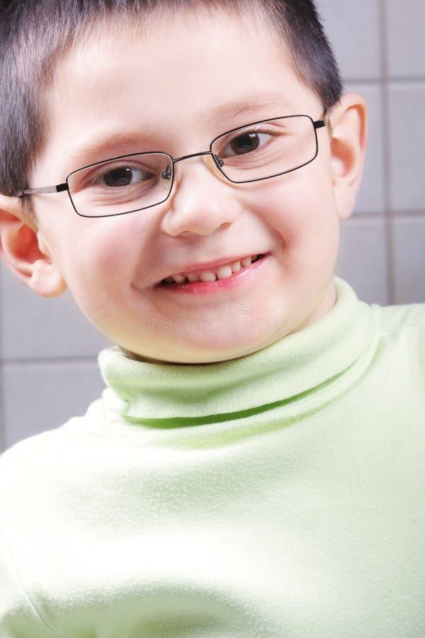 Download Smiling kid in eyeglasses stock image. Image of portrait - 12485307