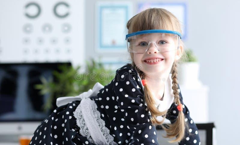 Smiling kid in eyeglasses stock images