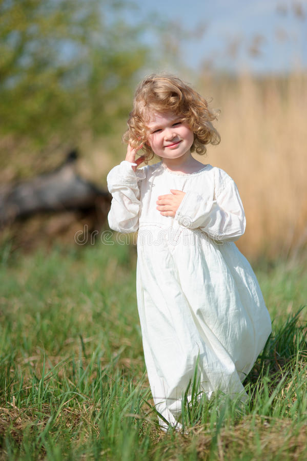 Free Smiling Kid Girl 4-5 Year Old Wearing Stylish White Dress Posing Stock Images - 74689634