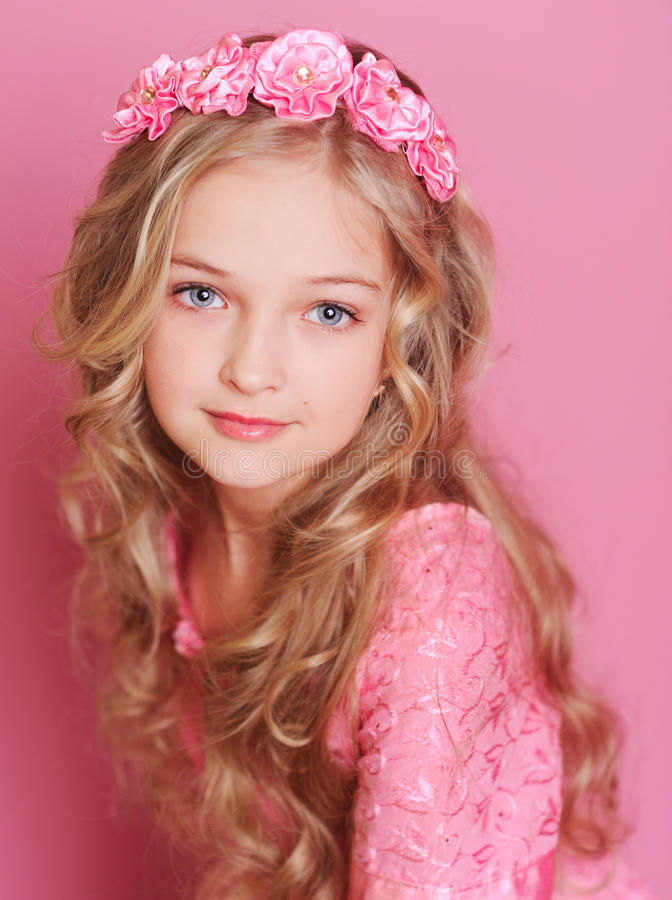 Smiling kid girl on pink royalty free stock photography