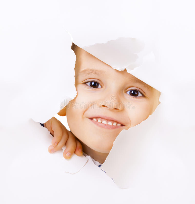 Free Smiling Kid Looking Out Of A Hole Royalty Free Stock Photos - 34174558