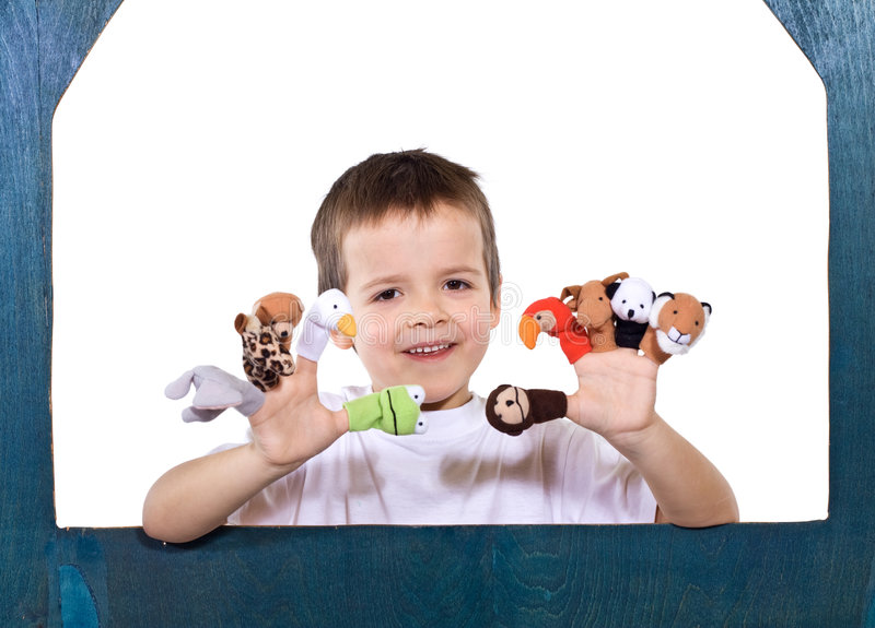 Smiling kid playing with puppets stock photography