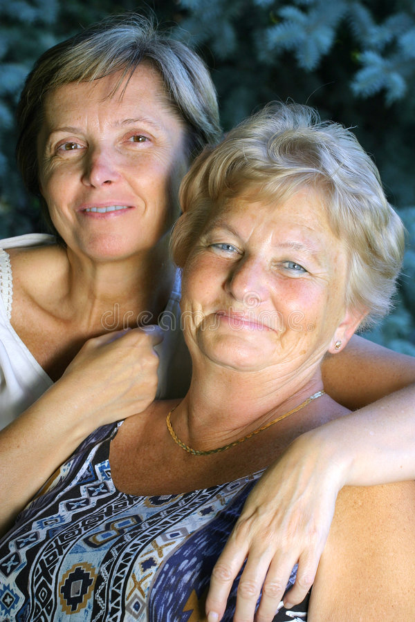 Smiling ladies. Two smiling ladies royalty free stock photos