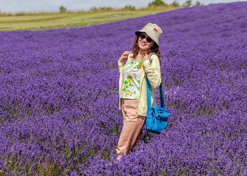 Smiling Lady in Lavender Field, Worcestershire, England. A happy and smiling female Chinese tourist posing in a Worcestershire Lavender field royalty free stock photography