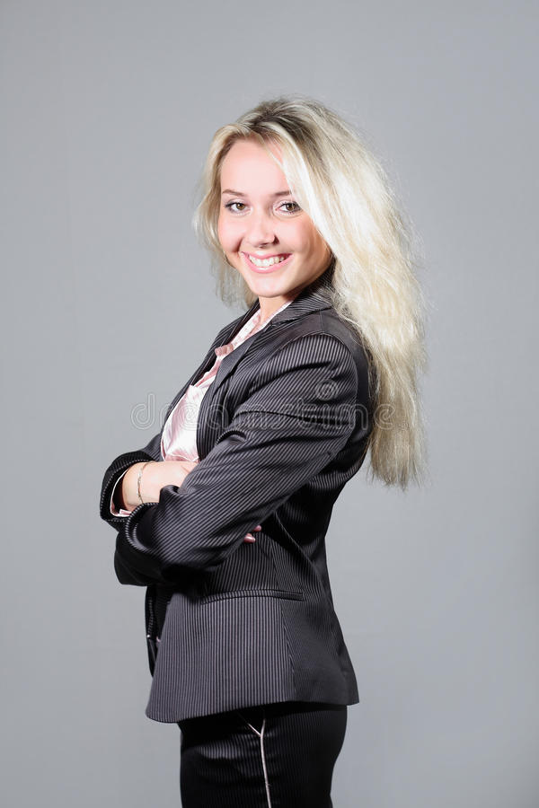 Smiling lady weared in business suit royalty free stock photography