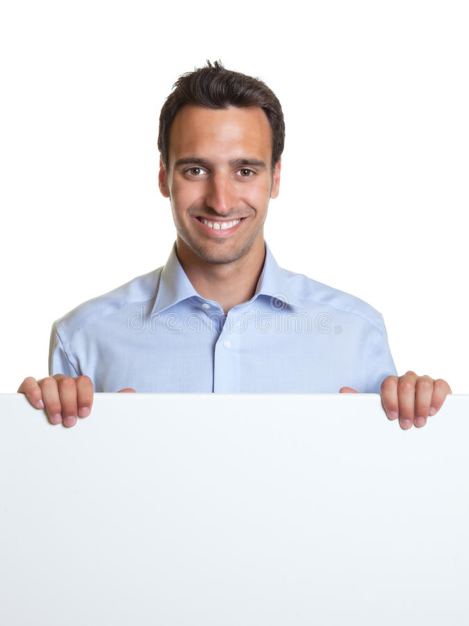 Smiling latin man with a signboard for advertising royalty free stock photo