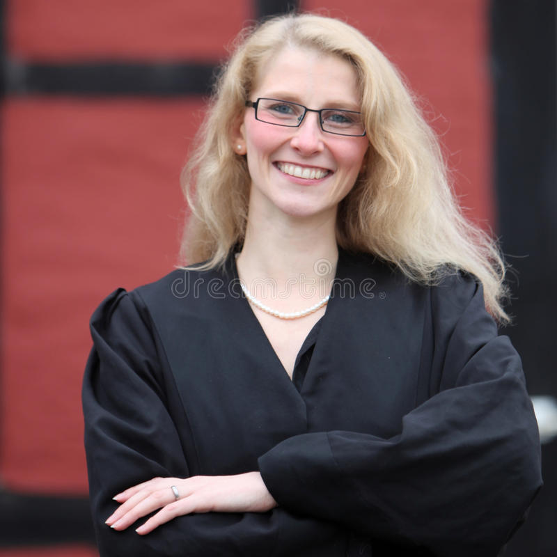 Smiling law student or lawyer in a robe royalty free stock photos