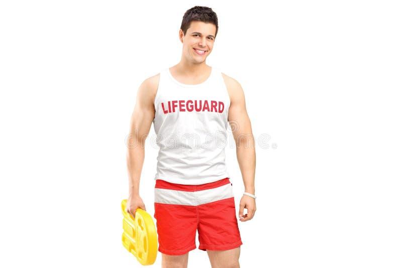 A smiling lifeguard on duty posing