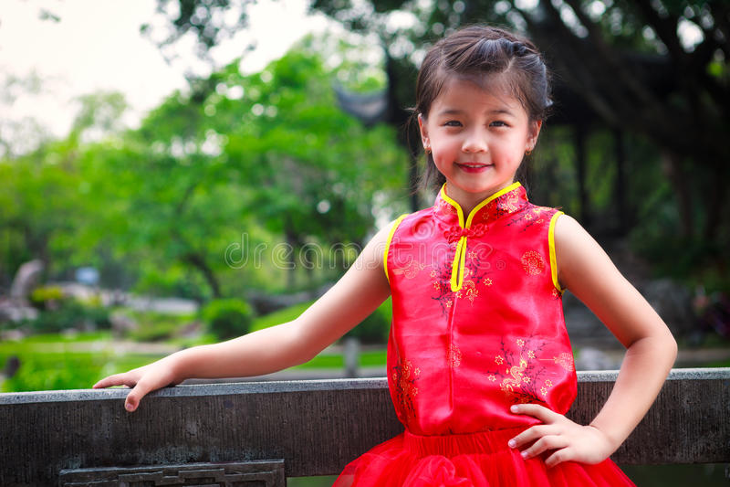Smiling little asian girl in chinese style dress royalty free stock photos