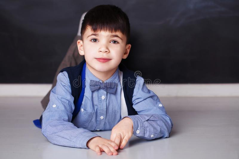 Smiling little boy in blue shirt looking at camera at home royalty free stock images