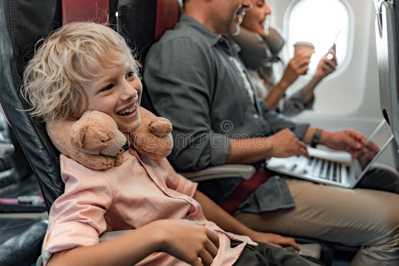 Smiling little boy while flying in an airplane stock images