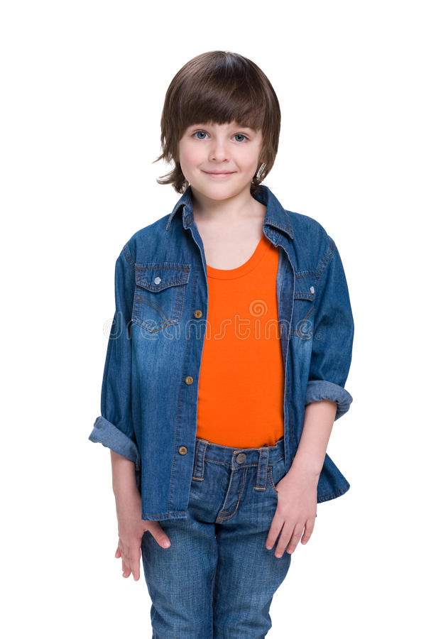 Smiling little boy in a jeans suit stock photos