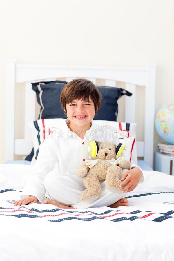 Download Smiling Little Boy Playing With A Teddy Bear Stock Photo - Image: 12642036