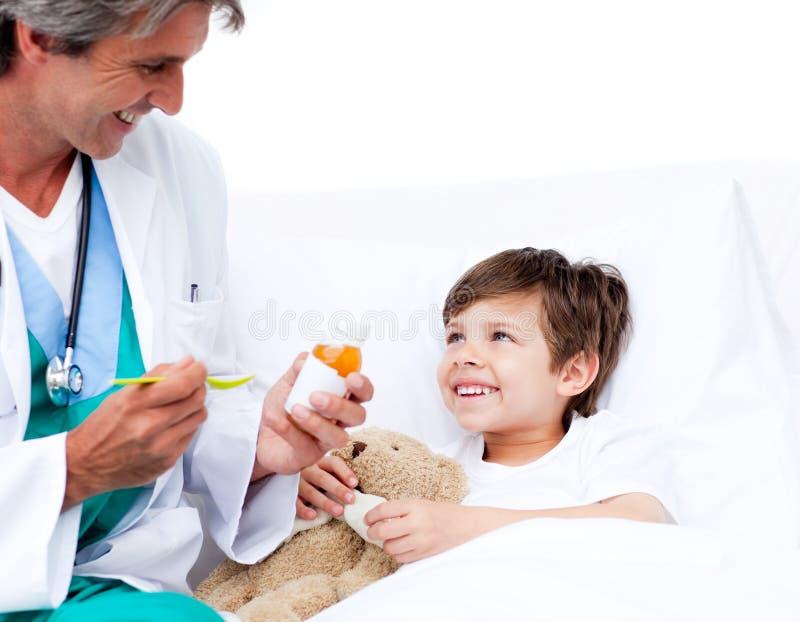 Download Smiling Little Boy Taking Cough Medicine Stock Image - Image: 12808629