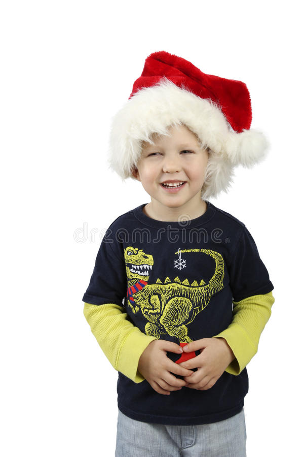 Smiling little boy wearing on red Santa helper hat. royalty free stock photos