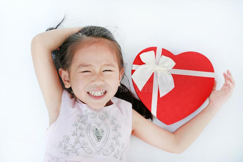 Smiling little child girl with red heart gift box isolated on white background stock image