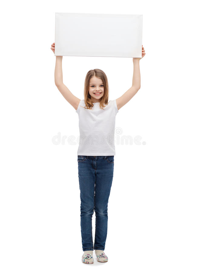 Smiling little child holding blank white board stock photography