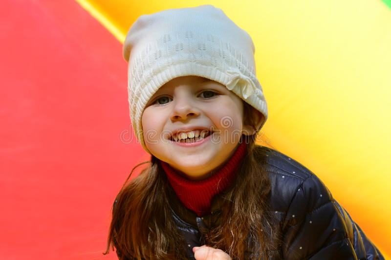 Smiling little girl at a bouncy castle royalty free stock image