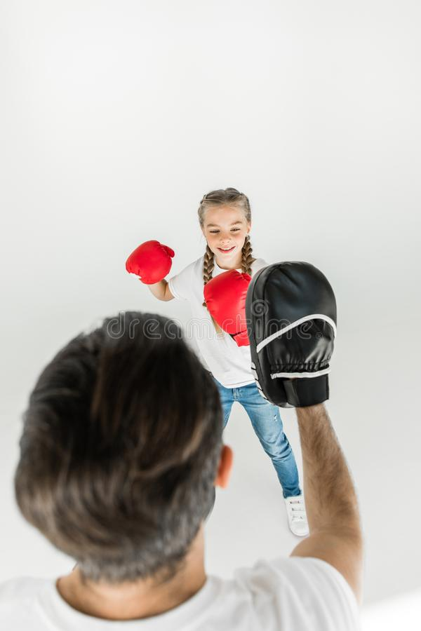 Father and daughter boxing together stock photography