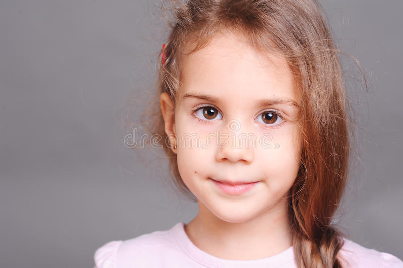 Smiling little girl closeup on gray royalty free stock images