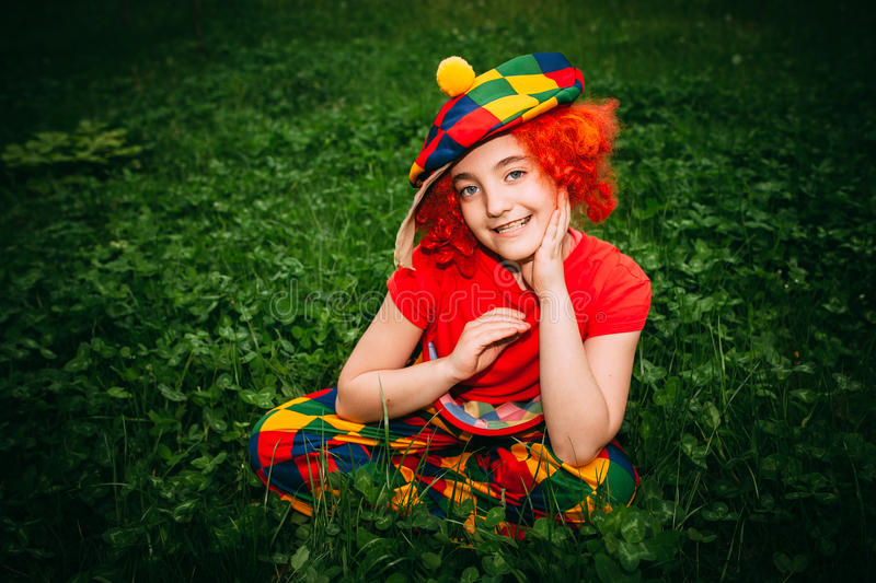 Smiling little girl in clown wig stock photos