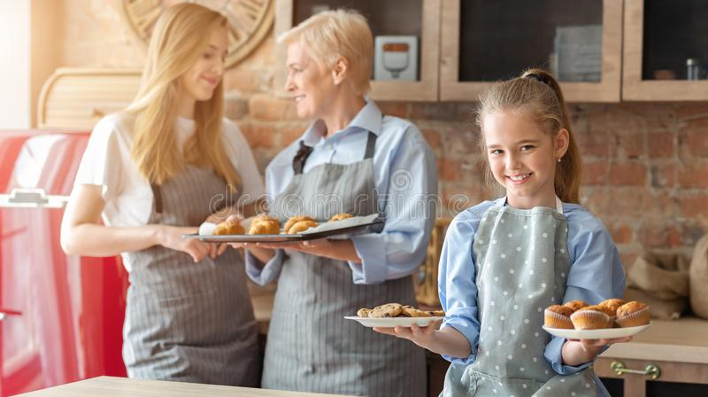 Smiling little girl demonstrating fresh home pastry royalty free stock photography