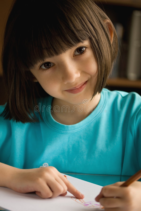 Download Smiling Little Girl  Draws. Stock Photo - Image: 8856972