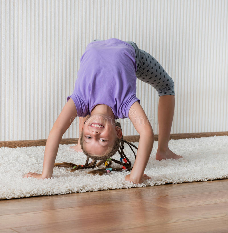 Smiling little girl engaged in fitness stock image