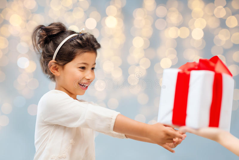 Smiling Little Girl Giving Or Receiving Present Stock