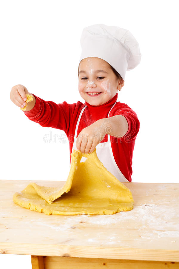Little girl kneading the dough royalty free stock photo