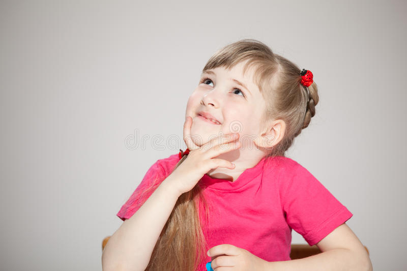 Smiling little girl looking up stock photography