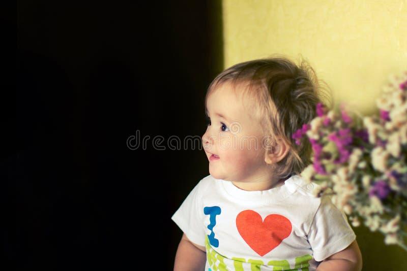 Smiling little girl looks away stock photography