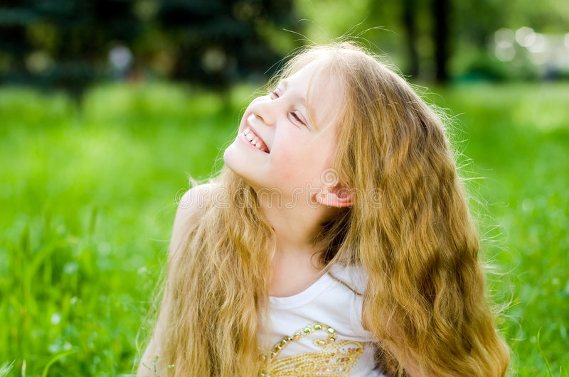 Smiling little girl outside stock images