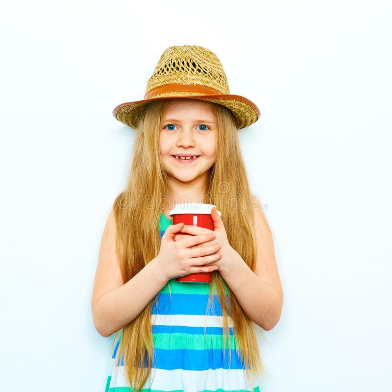 Smiling little girl portrait in hipster style with red coffee g royalty free stock photos