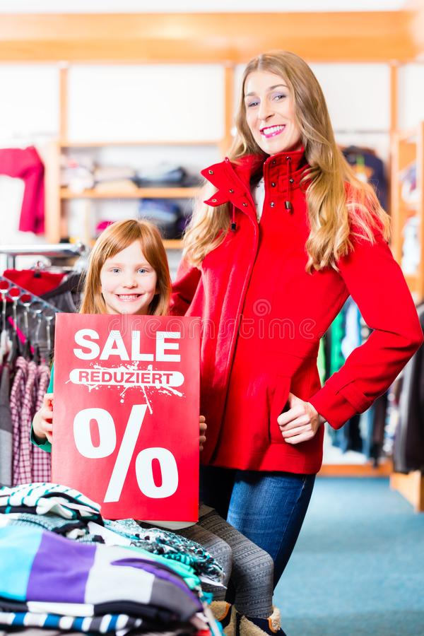 Smiling little girl promoting sale offer royalty free stock photo