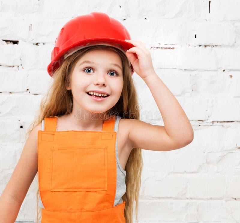 Smiling little girl in red helmet stock photos
