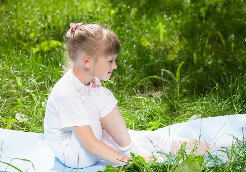 Smiling little girl resting in the park stock images