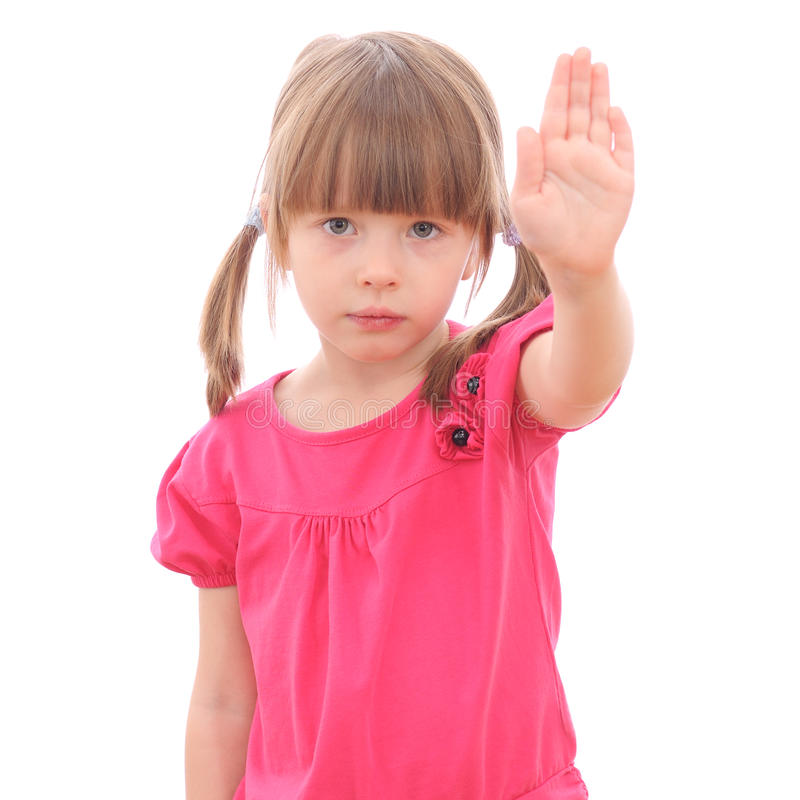 Smiling little girl showing her hand up royalty free stock photography
