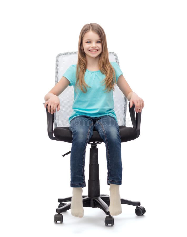 smiling little girl sitting in big office chair stock photo image 41311922. Black Bedroom Furniture Sets. Home Design Ideas
