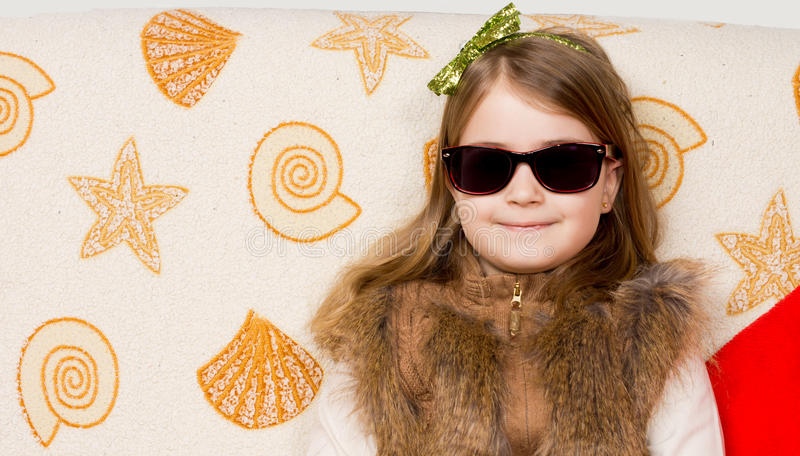 Smiling little girl in sunglasses stock images