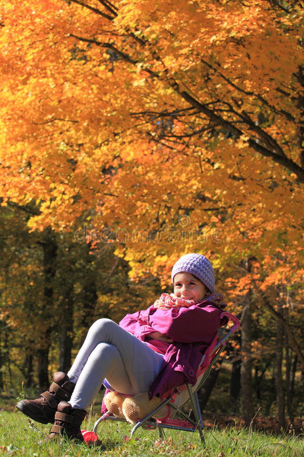 Free Smiling Little Girl Surrounded By Fall Colors Royalty Free Stock Photography - 27255417