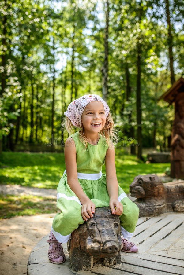 Free Smiling Little Girl Swinging On Wooden Pig Stock Photo - 66835990
