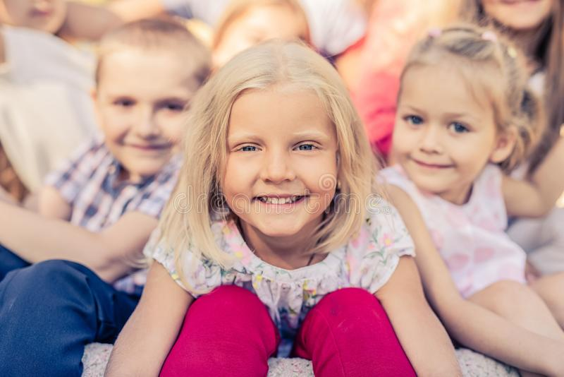 Smiling Little Kids. Sitting together royalty free stock image