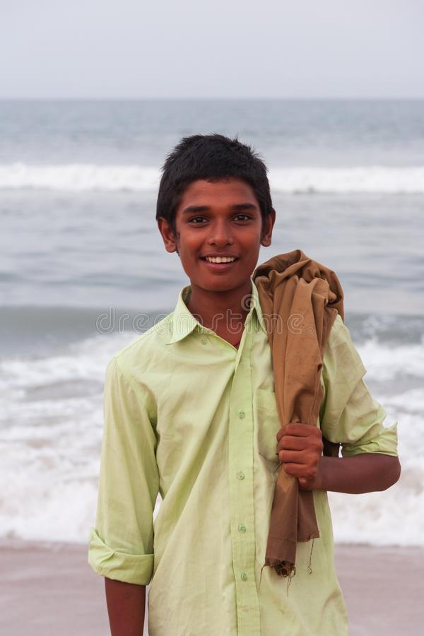 A smiling local boy poses for a photo at Marina Beach in Chennai royalty free stock photo